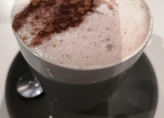 Coffee with a sprinkle of choc